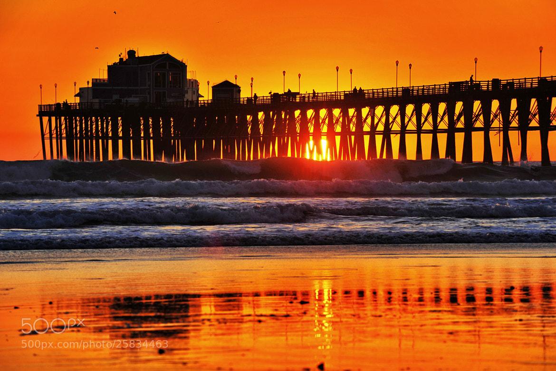 The Sun Peers Thru the Oceanside Pier - February 12, 2013