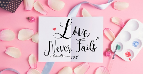 Love never fails on pastel background.